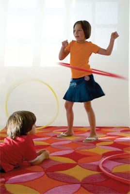 Cut a Rug - Sun-drenched, kid-friendly colors fill out the Psciodelia rug in a kaleidoscopic pattern that's intriguing enough to captivate artful adults. From Gandia Blasco in 100 percent hand-tufted wool, it's available in two room-transforming sizes; call for prices. Interior Illusions, 830 N. Palm Canyon Drive, Palm Springs, 325-0300.