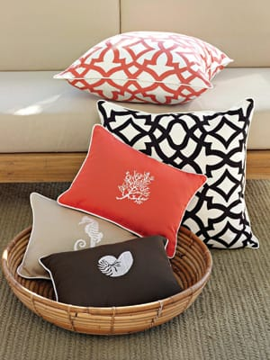 Sitting Pretty - Fresh summer hues combine sunny coral with soothing neutrals. Group Fan, Seahorse, and Nautilus embroidered pillows ($68 each) and Regency-style bold lattice prints in coral or chocolate ($88 each). (888) 922-4108, www.wshome.com.
