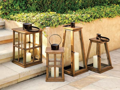 Lighting the Way - Cluster the Windowpane and Pyramid Vienna Hurricane Lanterns ($135-$195) around your pool or outdoor living room for ambient lighting that won't blow out when a breeze starts up. Teak wood lends the beachy look of a summer cottage at the Cape. (888) 922-4108, www.wshome.com.