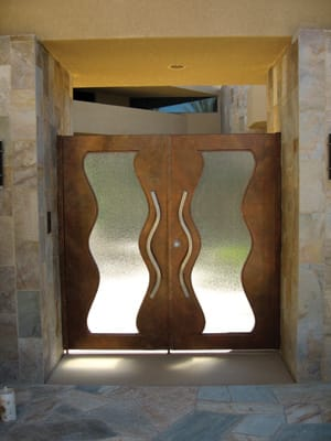 Open Up - Using a plasma cutter, artisans at Aladdin Door and Gate Co. translate your idea for a modern double door with a wavy cut-out of tempered glass; a curving, castle-worthy ornate hand rail; or an elaborate Old World gate into a custom piece crafted locally to last a lifetime. Andalusia at Coral Mountain in La Quinta called on Aladdin for the stately iron entry doors to each house, as well as the 13-foot-tall decorative entry door to the community's Racquet Club & Fitness Center, 83764 Ave. 45, Indio, 347-8403, www.aladdindoorandgate.com.