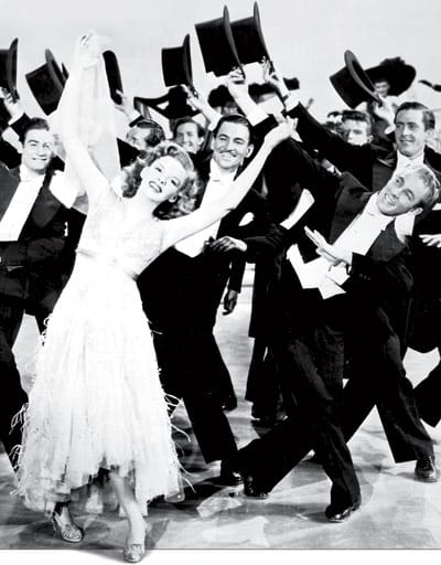 "In his first assignment for MGM, Norman Borine (front right) danced with Judy Garland in Till the Clouds Roll By. In Dancing with the Stars, he wrote, ""Judy walked, rather than danced, through many rehearsals, …. When the director finally called out 'Roll 'em,' the difference in her body movements and entire personality were like night and day. In fact, it wasn't long before all of us working with her nicknamed her 'one-take Garland.'"""