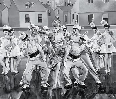 "Norman Borine (second male dancer from left) danced with Lucille Ball in Easy to Wed. ""[H]ere was a star who ran the gamut,"" he wrote, ""beautiful, crazy, loud and brassy, with the ability to become soft and tender. Along with all of this was an underlying intelligence, which all too often was not evident in top entertainers."""