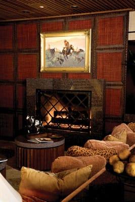Frederic Remington's Navajo Raid hangs in the family room.