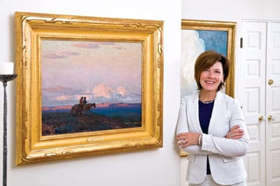 Diane Stewart and her husband, Sam, count among their collection of Western paintings The Navajos by Edgar Payne.