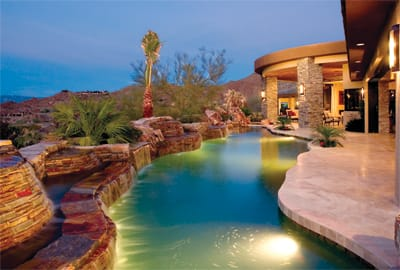 This stunning Bighorn Golf Club resort home designed by Graystone Construction of La Quinta has water at its heart, making an afternoon swim an experience filled with sight and sound. The multilevel waterfalls splash and flow into a stylish swimming pool surrounded by lush landscaping and mountain views.