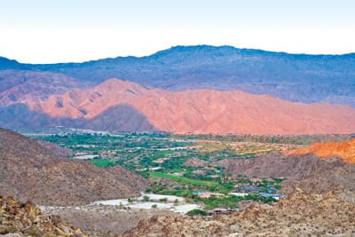The 6-mile loop trail from The Living Desert in Palm Desert offers panoramic views of three exclusive country clubs: The Reserve and Ironwood Country Club to the southwest and The Vintage Club. At the right time of day, you can see the shadow of Eisenhower Peak on the hillsides to the southwest