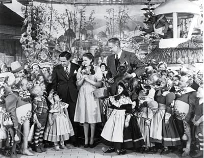 Mervyn LeRoy, Judy Garland, Victor Fleming, and the Munchkins.