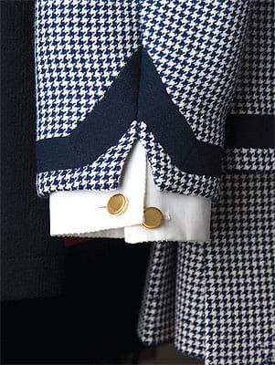 Signature details help identify authentic couture. Cuffs on a Chanel jacket can be detached for cleaning.