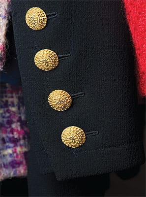 Signature details help identify authentic couture. Dramatic gold buttons with functioning buttonholes are an Yves Saint Laurent staple.