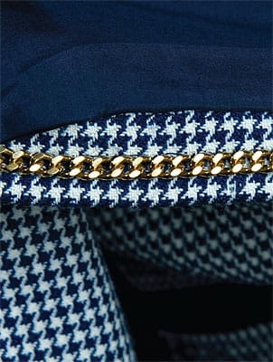 Signature details help identify authentic couture. Chain on a hem gives a Chanel jacket hem weight.