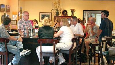 Louis Lucas entertains guests in the Lucas & Lewellen Vineyards tasting room.