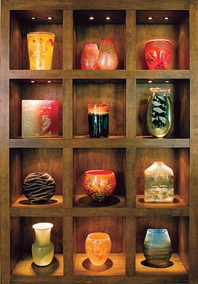 (from top shelf): Chris Pantano, River Stones vase (2003), blown glass; Keith Rowe, Bush Fire Series (2003), blown glass; Chris Pantano, Primal Pattern vase, blown glass; Sean Albert, Intentionally Random Line Study (2007), kiln-formed glass (on exhibit at Palm Springs Art Museum); Paul Marioni, The Visitor (1985), blown glass; Hiroshi Yamano, From East to West Fish Catcher #212 (2003), blown glass; Fornace Mian, Vivarini III (2003), Murano glass with hand grinding; Richard Lamprect, Cane Bowl (2003), blown glass; Holly Grace, Landscape Bottle (2007), blown and sandblasted glass; Venini Glass, vase, blown glass; Chris Pantano, River Stones vase (2005), blown glass; and Grant Donaldson, Landscape Form (2003), blown glass