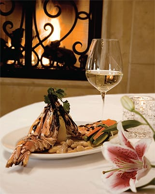 An entrée of Colossal Grilled Prawns with shaved black truffles, steamed vegetables, and borlotta beans, a special choice from the extensive La Spiga menu. Chef Cultraro suggests that a fine chardonnay is an excellent pairing with this dish.