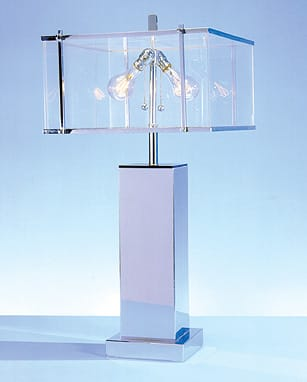 Though not an architect, Charles Hollis Jones began designing cabinets, lamps, and tables for his father's house-pattern business. His talent with all things translucent made his lamps and desks design-house staples and earned this 33-inch Lucite and metal Edison Lamp a California Design 11 award, honors from the German government, and a spot in the Pasadena Museum of Modern Art. Jones proves that innovation and illumination make a stunning pair. $3,500.