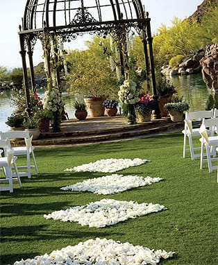Diamonds are an aisle's best friend in this stylized design of white rose petals by Artisan Event Floral and Décor.