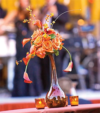 Unafraid to show a little stem, Shari Kelley Events let calla lilies leap from these unusually sculptural arrangements.