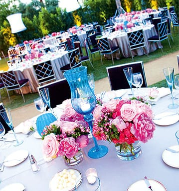 In colors to complement the chocolate-brown chairs at Parker Palm Springs, Laverty surrounded his hot-pink floral arrangements with blue champagne flutes purchased in bulk and 150 pieces of vintage blue glass he rented for the occasion.