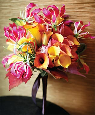 Laverty hand-wired this lush and brilliant bouquet; the skinny stem feels less cumbersome than hand-tied versions.