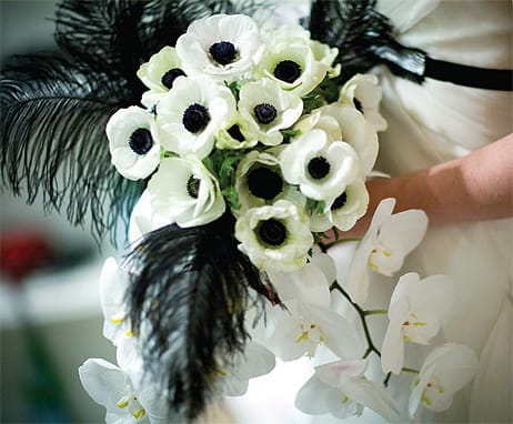 Laverty procured black-and-white anemones to complement the black velvet sash on the bride's gown. Black feathers and a cascade of orchids complete the haute couture look.