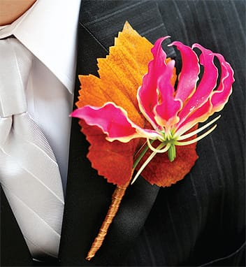 This stunner by Keith J. Laverty Floral and Event Design makes a sentimental statement beyond its good looks: Because the groom was from Canada, Laverty placed this hot-pink flower against a maple leaf backdrop.