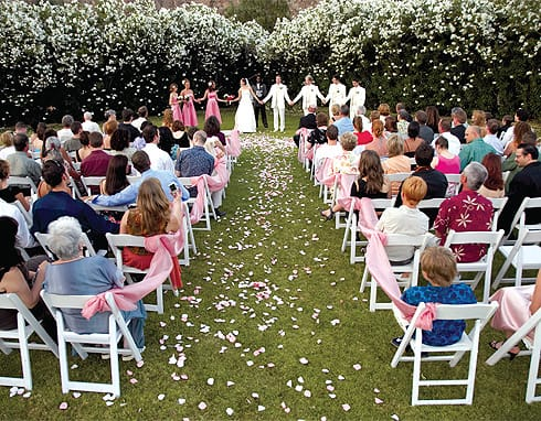 """A local service can help you find and reserve a private estate for your ceremony and reception. You'll feel like a couple of """"old Hollywood"""" celebrities when you pull up to a walled compound and step inside to find your own pad, pool, and grounds ready for a full weekend of wedding excitement."""