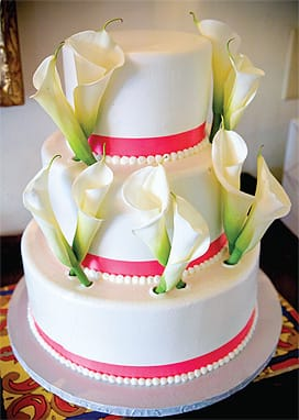 Crayons Catering produced this fresh and simple design to match the bride's white calla lilies bouquet tied with pink ribbon.
