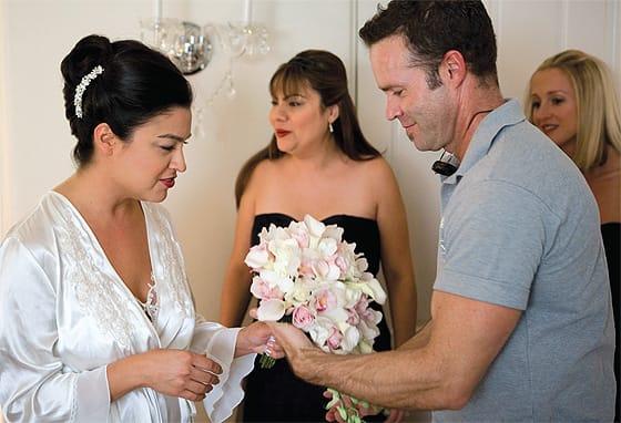 Joey Lizotte presents a bridal bouquet.