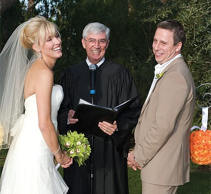 Rev. Richard Cadieux knows how to put couples at ease. Flowers by Artisan Event and Floral Decor.