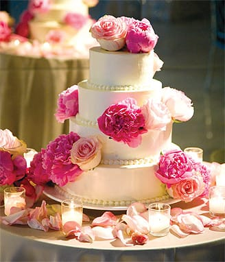 Floral designer Keith J. Laverty placed hot pink peonies and pale pink roses on this cake by the pastry chef at Parker Palm Springs.