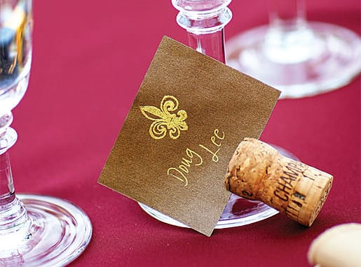 Do-it-yourself brides save money — and the environment — with place cards made from repurposed wine corks. A few sheets of handmade paper, a fancy pen, and matching stamp with inkpad were all it took for Julie and Aaron to make these. Cut costs by serving only beer and wine at the reception, suggests wedding planner Cathy O'Connell, and these place cards will put guests in the mood for the simple pleasure.