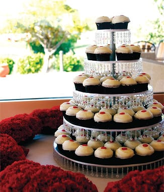 Shelby and Josh, relieved that Cimmaròn Golf Resort could host their wedding on only eight weeks' notice, skipped the traditional wedding cake and invited guests to help themselves to five tiers of cupcakes from Sherman's Deli & Bakery.
