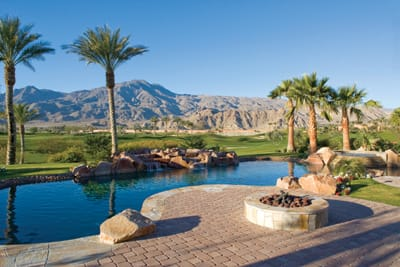 A fire pit, pool, and breathtaking views invite outdoor entertaining at the Steinke home.