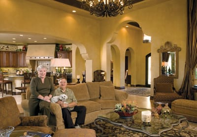 Nuala and Don Steinke relax with their Maltese, Taaffe, in the great room of their Estrella residence.