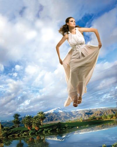 Juan Carlos Obando's beige double-layer chiffon dress with white pleated chiffon bodice.