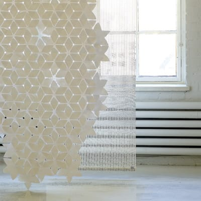 Divide your space with the pristine crispness of Mia Cullin's snowflake-inspired room divider. Fashioned from flexible Tyvek, the screen arrives as 160 interlocking pieces that link together to form a pattern that is minimal and elegant. Link the components into countless constellations to create window treatments, room dividers, or table decorations. $203. www.suiteny.com