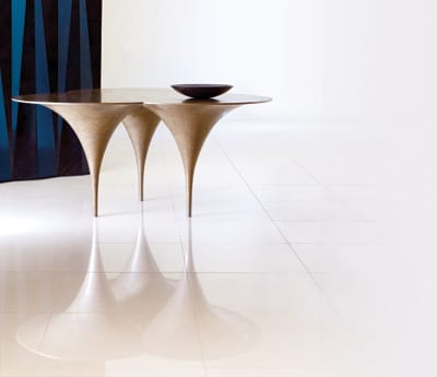 Pushing the intersection of design and art while maintaining real-world usefulness, the Morotai table by Carlo (available exclusively through Nusa in Los Angeles) balances on three minimalist feet. Forged from pure brass terrazzo, it brings novelty to any room. $9,500. www.nusafurniture.com