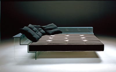 The simple lines and transparent steps of Carlo Santambrogio's corner bed reveal an edgy glamour. The Diamant glass is laminated and tempered for safety, while the recessed legs give the illusion of a floating mattress. $30,000-$44,000, depending on dimensions. www.luminaire.com