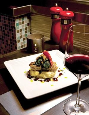 A specialty from their Individuality menu is the Pepper-Crusted Ahi Tuna with baby spinach, sweet onions, huckleberry demi-glacé and celery root purée. The suggested wine is The Eyrie Vineyards, Williamette Valley, Oregon, Pinot Noir.