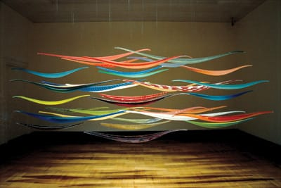 Lino Tagliapietra created Endeavor (1998-2003), an installation of 35 boats, in blown glass with multicolor canes.