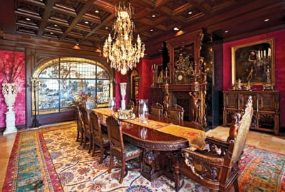 Ornately carved wood, a coffered ceiling, and a panel of stained glass from a church in Italy set a grandiloquent tone in the dining room.