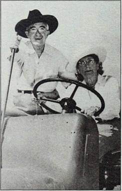 Austin G. McManus and spouse Pearl on their tractor in Palm Springs.