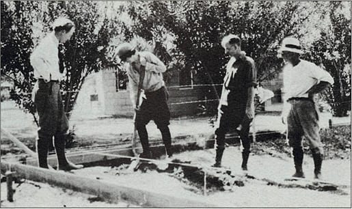 Architect Lloyd Wright (left), contractor Quinn Spalding (second from right) and Austin McManus watch as Pearl turns over the first spade of dirt to begin construction on the Oasis Hotel.