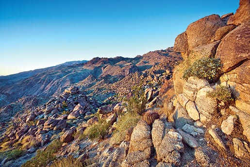 """About 30 minutes from the start of the Art Smith Trail, hikers reach this rocky haunt. The small barrel cactus in a nest of rocks provided the foreground focus for photographer Tom Brewster just past sunrise. """"Sometimes you have just that one moment to define a place,"""" he says."""