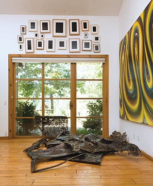 Works by Allan McCollom (above slider), Cal Lane (floor), and Karin Davie.