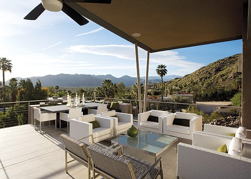 The home's limestone-floored terrace and angled roof face eastward, their inspiration coming from Jakway's love of Palm Springs' midcentury elements. Tidelli patio chairs surround a granite table he designed and had fabricated locally by Sierra Marble. Chunky, raw Murano glass candlesticks, a special keepsake from a trip to Venice, provide additional heft to the sleek tabletop. Tension steel cable in custom steel supports surround it all.