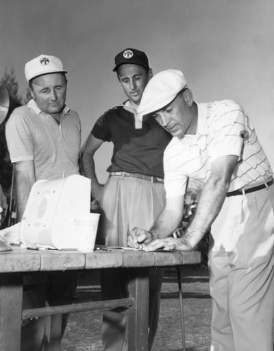 Ben Hogan enters his scorecard in 1954.