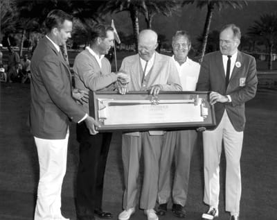 President Dwight D. Eisenhower congratulates 1964 tournament winner Tommy Jacobs. Presenters are tournament officials Paul Jenkins (far left) and Robert P. McCulloch (far right), who played a key role in recruiting Eisenhower into the prize-giving mix.