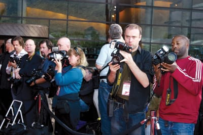 Photographers line the red carpet outside the convention center.
