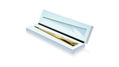 Gold-plated letter opener in a box, part of Vladymir Rogov's Desk Architecture series.