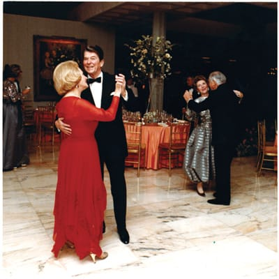 Leonore Annenberg dancing with Ronald Reagan and Walter Annenberg dancing with Nancy Reagan